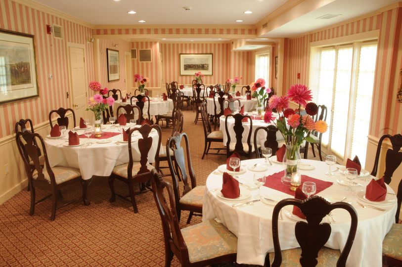 Our main dining room featuring centerpieces with beautiful dahlias that are grown right here on our...