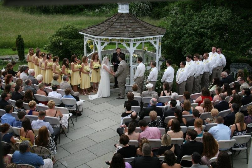 A ceremony of 160 guests at our gazebo with blue stone patio.