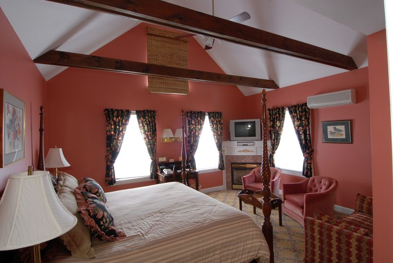 Room 209, beautifully decorated king room with fireplace and vaulted ceiling.