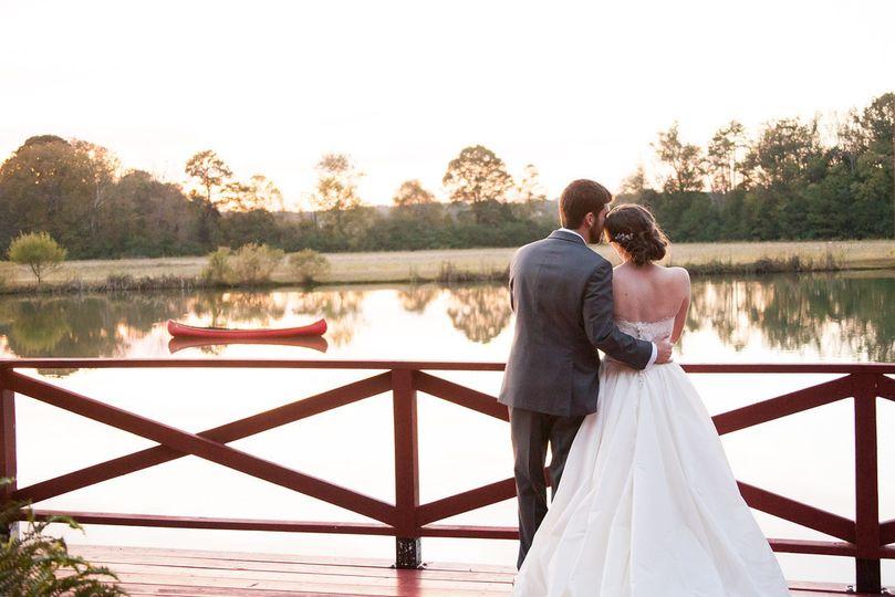 Newlyweds overlooking the lake