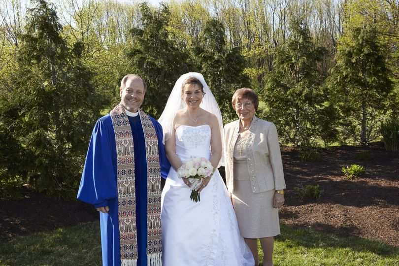 Officiant with the bride and mother