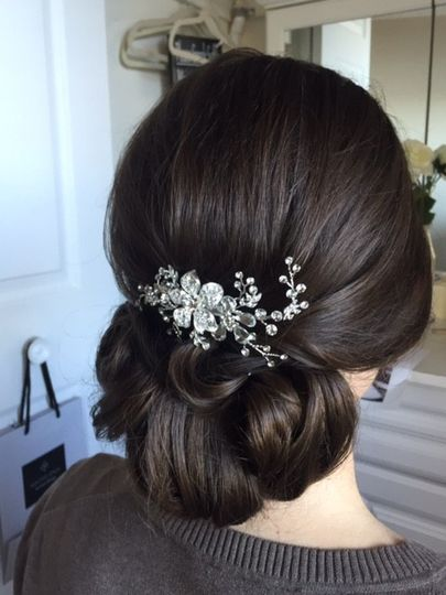 Neat wedding updo with accessory