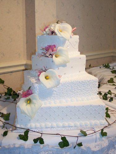 4 tier square cake with fresh calla liles.