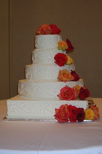 5 tier bride's cake with fresh flowers