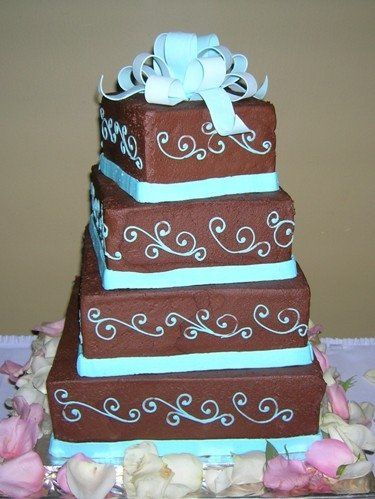 4 tier chocolate brown bride's cake with turquoise designs