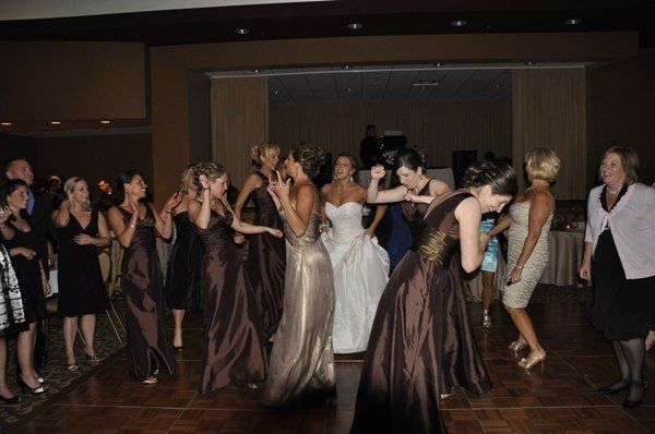 The bride with her bridesmaid dancing