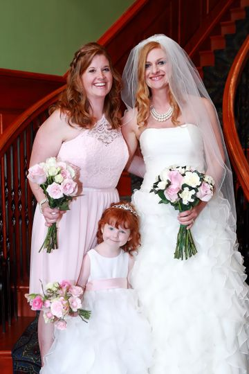 Bride and bridesmaid with flower girl