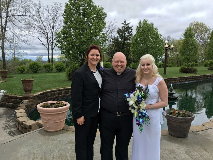 With the happy officiant
