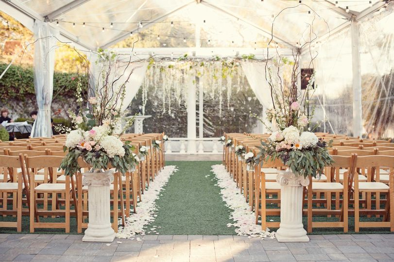 A romantic tented ceremony, ready for all weather.