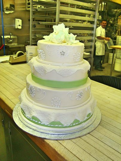 4-tier wedding cake with green details