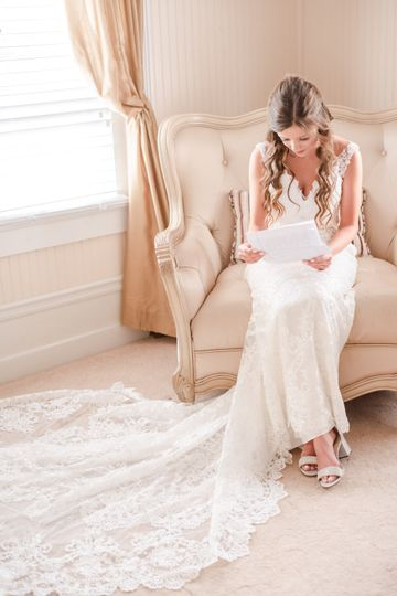 Reading letter from Groom