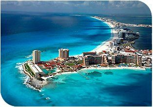 Aerial view of Cancun's beautiful Hotel Zone with pure-white sand beaches & warm crystal clear...