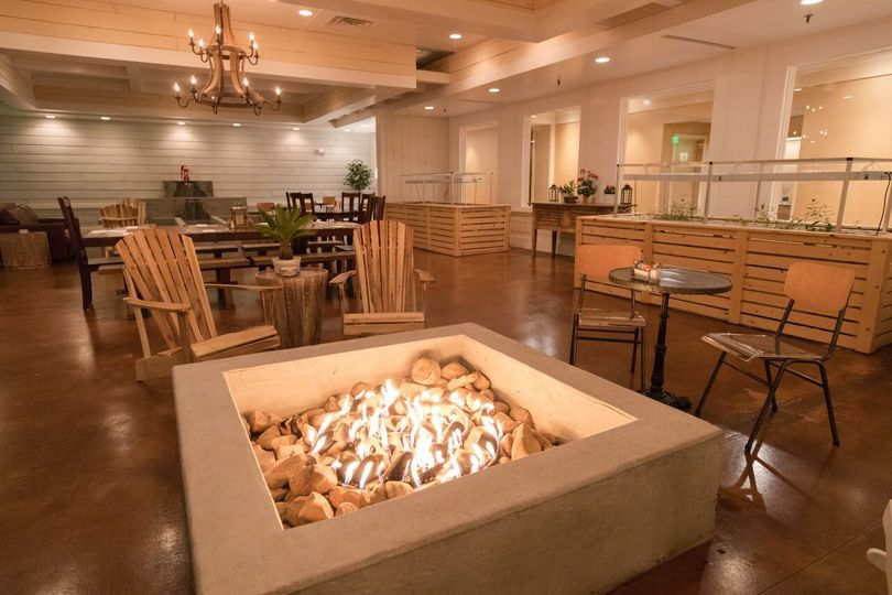 """Our indoor """"outdoor style"""" Barn Room patio room complete with large cascading fountain, fire pit..."""