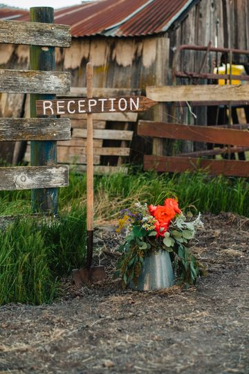 Antique farm tools transformed into charming event signage.