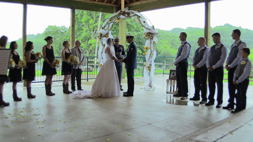 Indoor ceremony with pond in the background