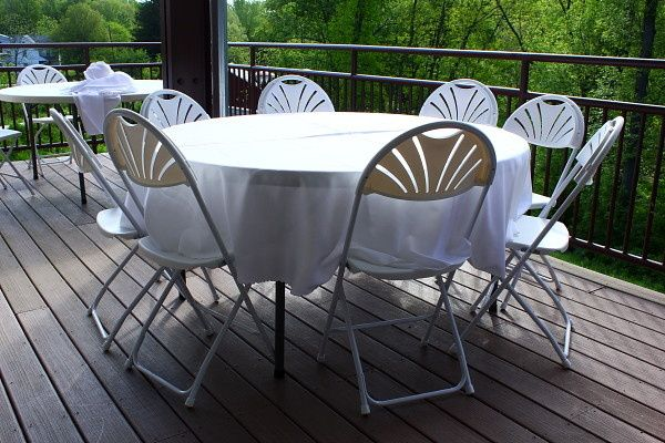 60 inch round tables and fanback chairs.
