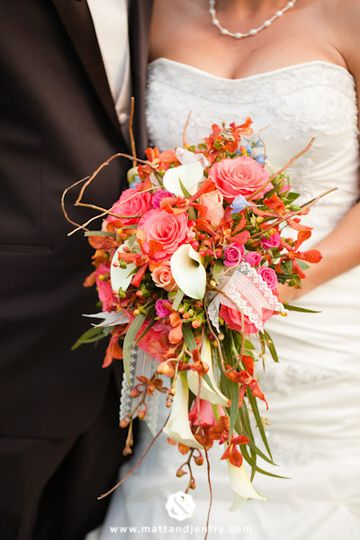 Gorgeous salmon, pink, and peach cascading bouquet.
