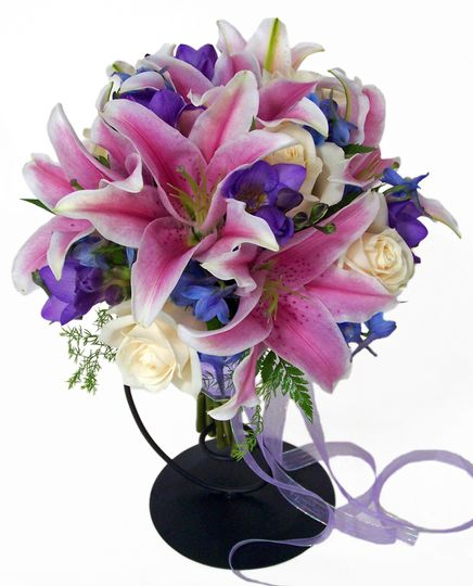 Stargazer lilies, deliphinium, and roses make a beautiful bouquet.