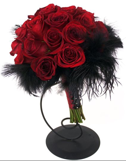 Stunning red roses accented with black feathers and ribbon!