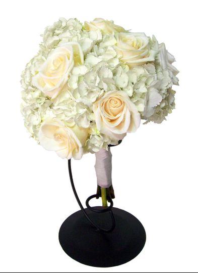 Ivory roses and white hydragea make this elegant wedding bouquet shine!