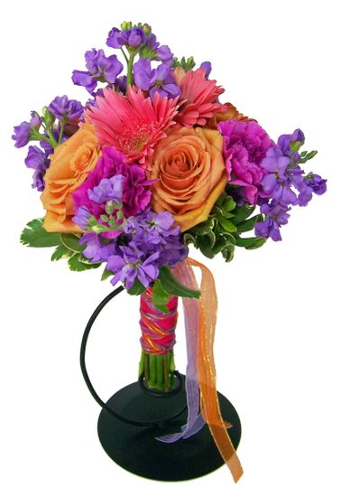 This bouquet screams spring and summer with its vibrant rose, stock, and gerbera daisy colors!