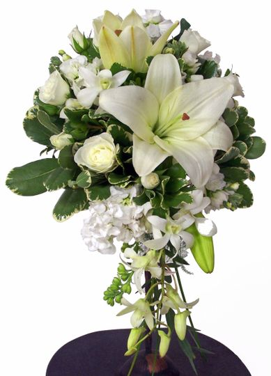 White lilies, roses, and orchids make this beautiful cascade wedding bouquet.
