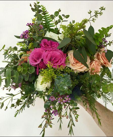 Hand tied bridal bouquet with a wild flower twist!