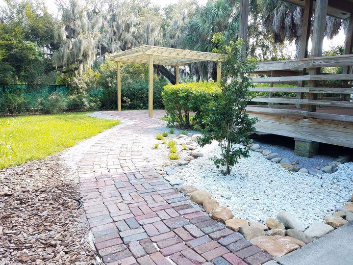 Brick walkway with pergola