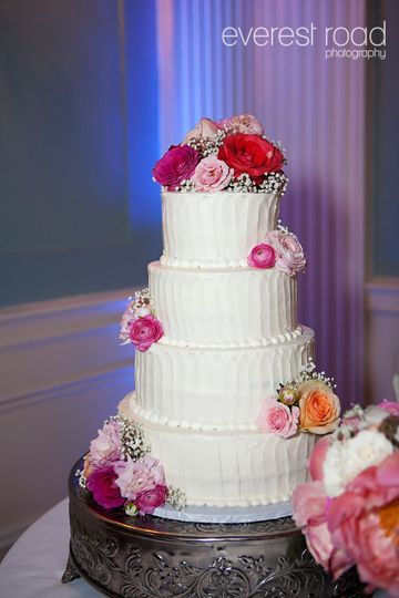 Four tier cake with flowers on top