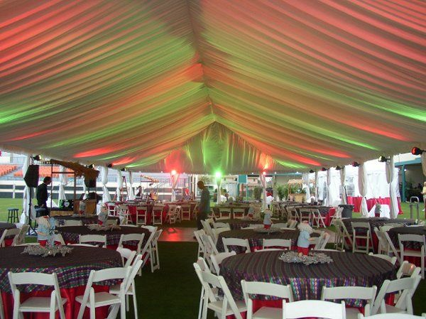 "40x100 tent with white liner, leg covers and color lighting, white wood chairs, 72"" round tables and..."