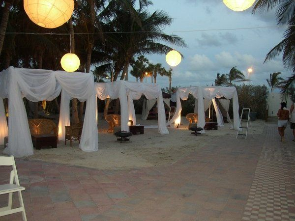 8x8 south beach cabans with white drape fabric, up lighting and some oriental hangin lamps.