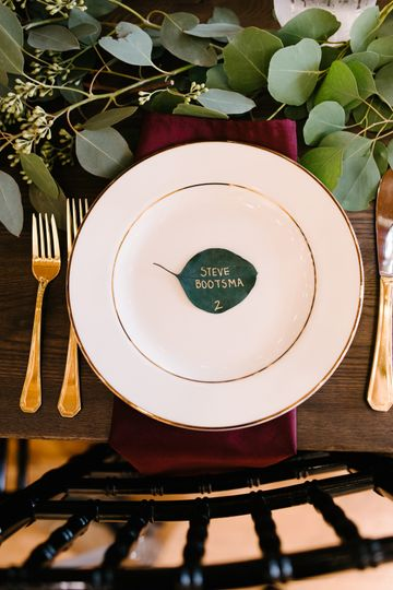 Place settings with greenery