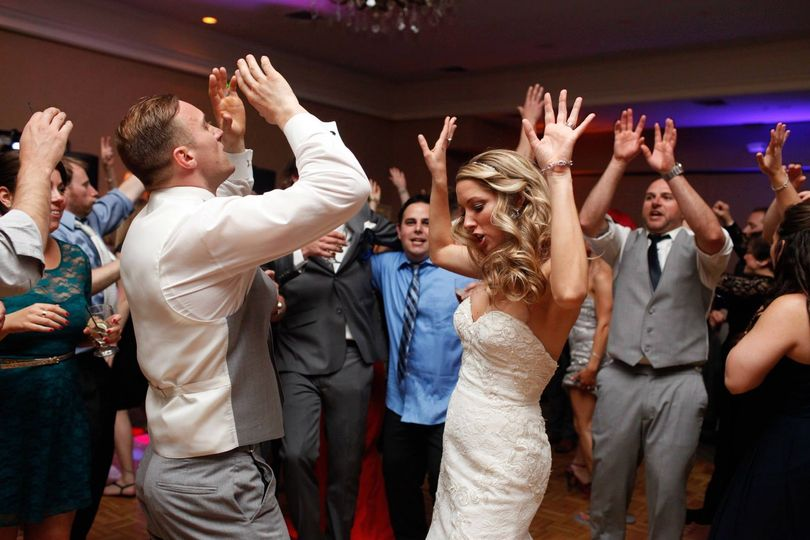 The couple dancing with their guests