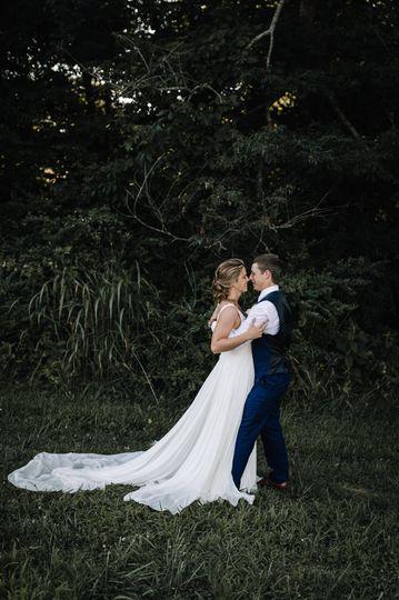 Newlyweds holding each other | Billie-Shaye Style Photography, LLC