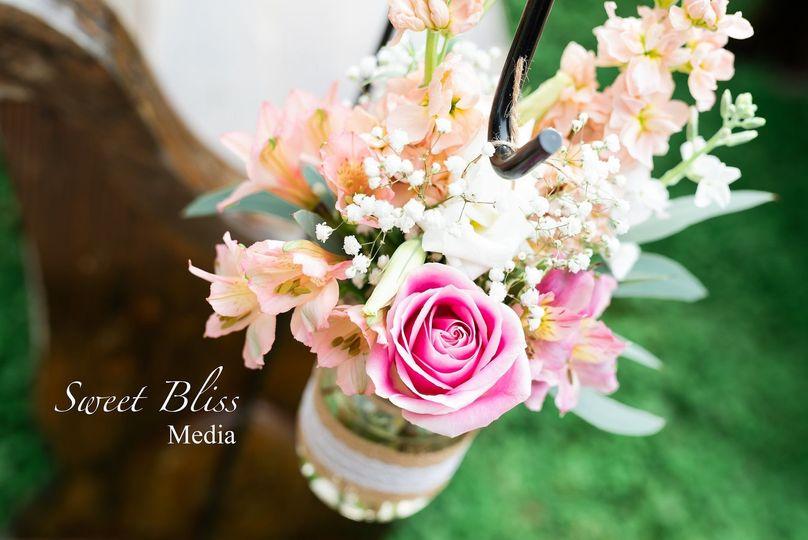 Aisle decor of roses, lisianthus, stock, baby's breath