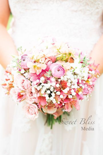 Bridal bouquet of roses, ranunculus, gerber daisies, lisianthus, stock, baby's breath
