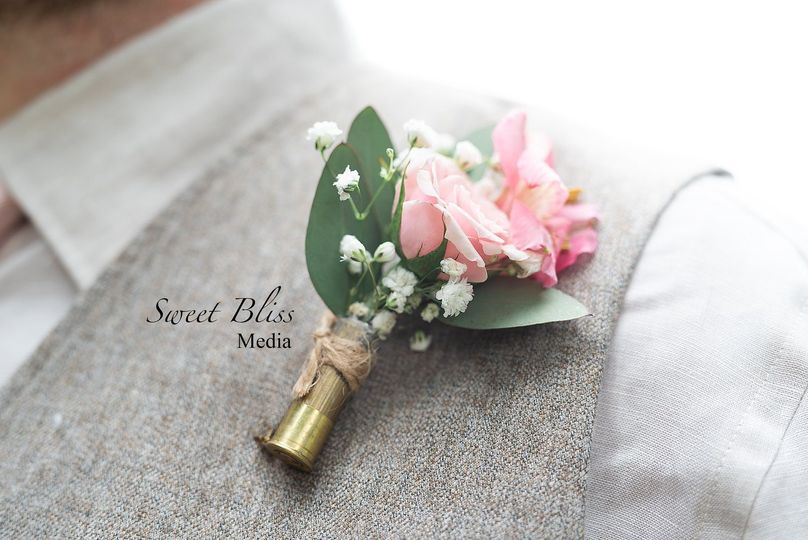 Boutonniere with spray rose, alstroemeria and baby's breath in shotgun shell