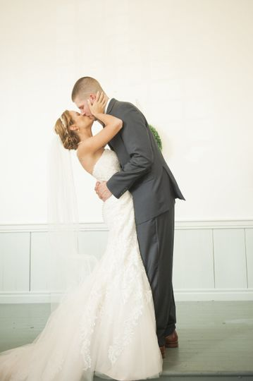Groom kissing his bride