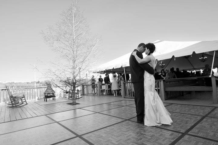 bride and groom dancing on back deck