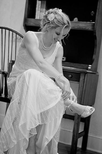 Bride wearing her shoes