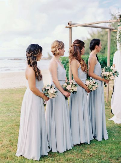 Bridesmaids show off variations of hairstyles