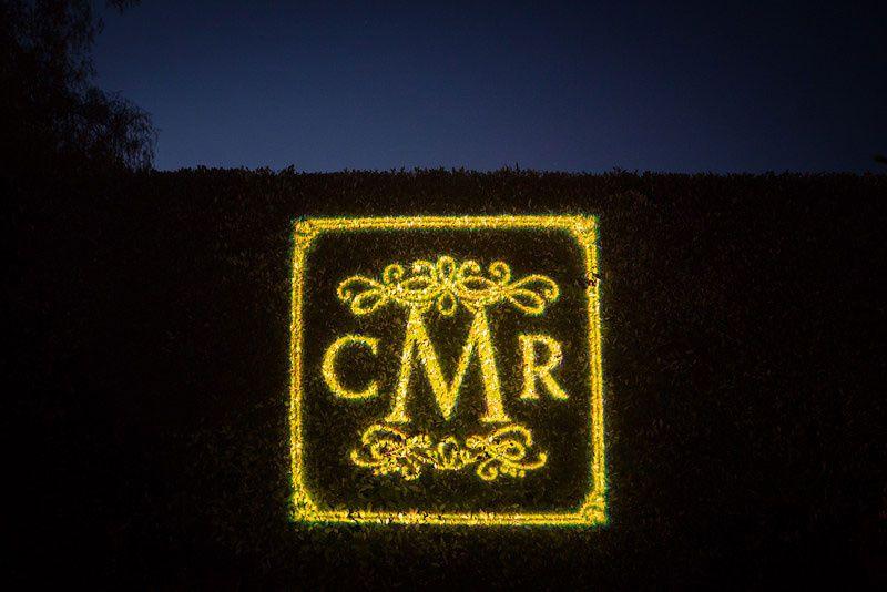 Gobo-Monogram-on-Foliage-Rancho-Santa-Fe-Lighting