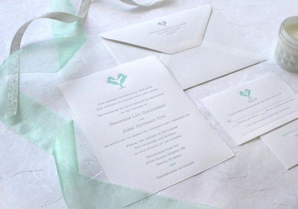 White invitation with a touch of teal