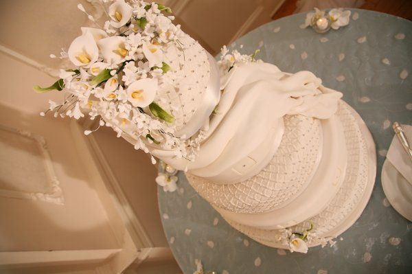 The pastry chef did a beautiful job in recreating the 'quilted' look of the bride & groom's...