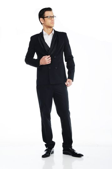 The Andy Tuxedo  4 Button double-breasted jacket with a slight sheen, featuring jetted pockets and a...