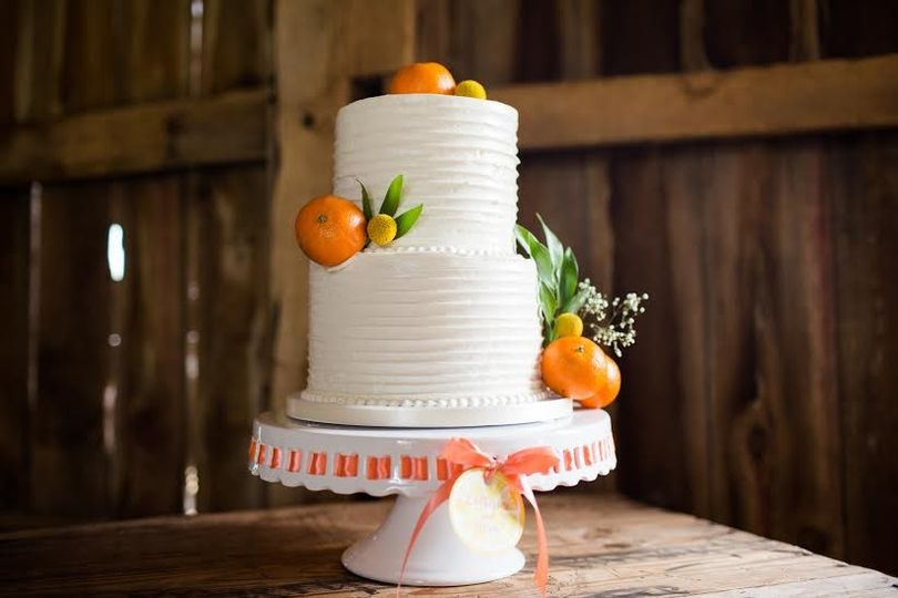 White wedding cake with oranges