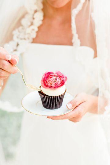 Bride eating a cupcake