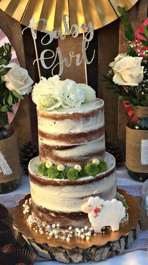 Naked wedding cake on a log