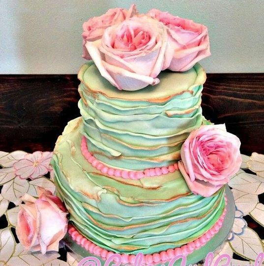 Colorful wedding cake with pink roses