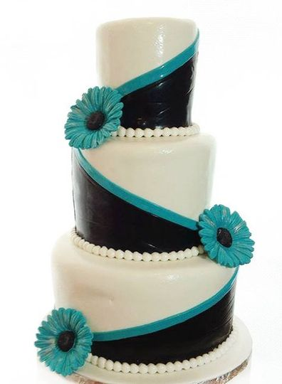 Black and white cake with blue detailing